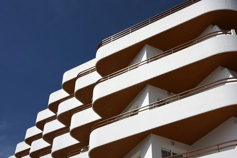 white and orange hotel facade with balconies