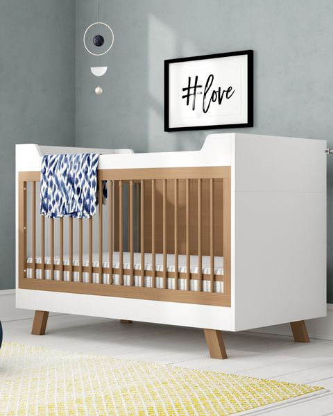White and wooden cot