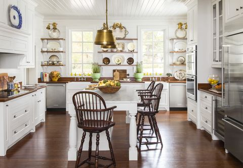 white kitchen cabinets  - natural wood countertops