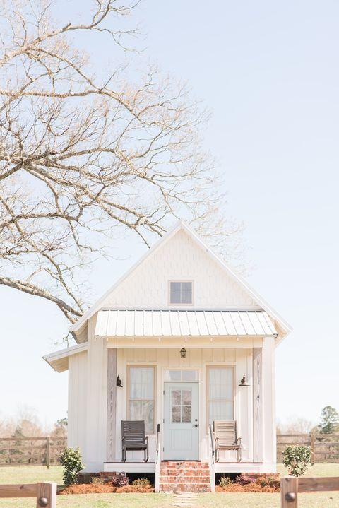 white farmhouse with light blue door
