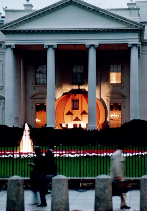 washington,   a 17 12  by 21 foot jack o lantern adorns the north portico of the white house, 26 october 1993, as pedestrians walk on pennsylvania ave  the plywood pumpkin was illuminated prior to the traditional celebration of halloween 31 october photo credit should read paul j richardsafp via getty images