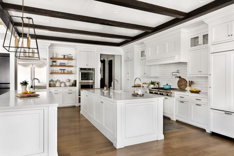 white kitchen with two islands storage