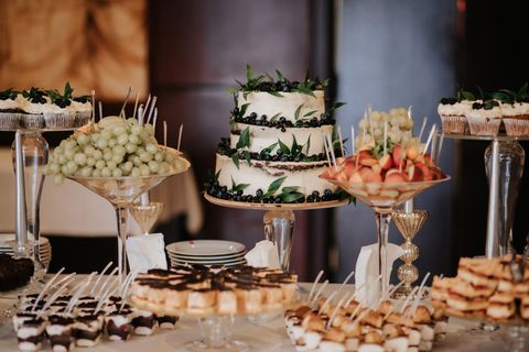 white nude wedding cake by decoration on table