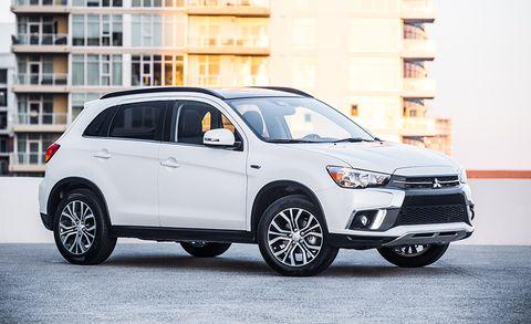 Land vehicle, Vehicle, Car, Motor vehicle, White, Automotive design, Mitsubishi, Luxury vehicle, Rim, Sport utility vehicle,