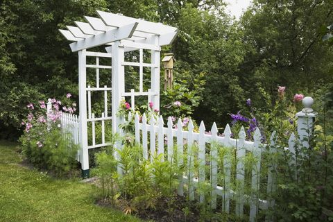 Decorative Outdoor Picket Fence White  from hips.hearstapps.com