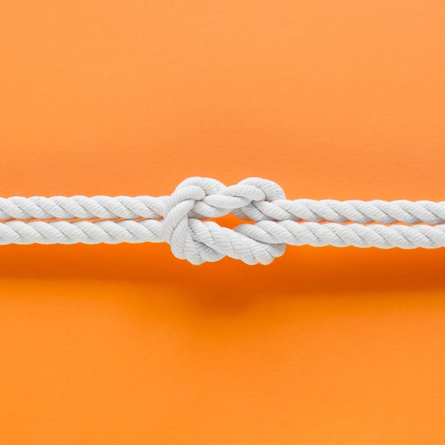 white ship ropes connected by reef knot