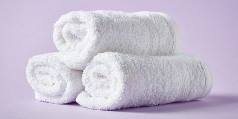 White spa towels on purple background