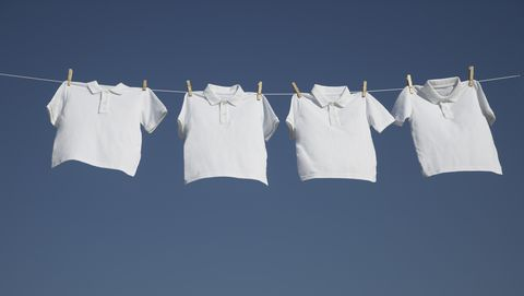 White t-shirts on a washing line.