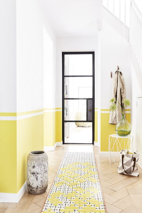 hallway with a black framed door, walls are painted yellow half way up from the bottomline it upcareful use of masking tapeand a spirit level is the key tocreating this linear paint effectpaint each section in turn, andallow it to dry before movingon to the next one