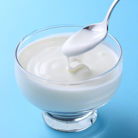 White Yogurt on blue background