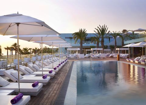 Resort, Swimming pool, Building, Vacation, Hotel, Architecture, Leisure, Real estate, Leisure centre, Sunlounger,