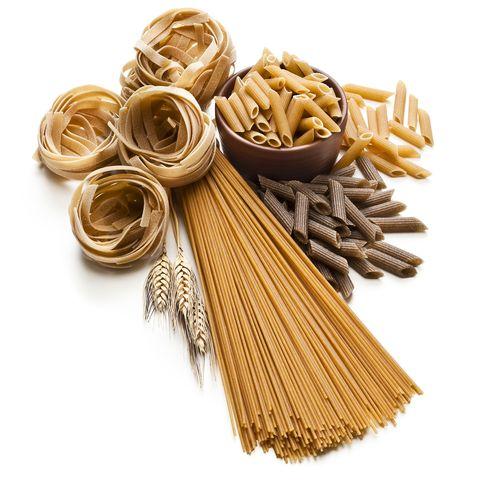Wholegrain pasta isolated on white background