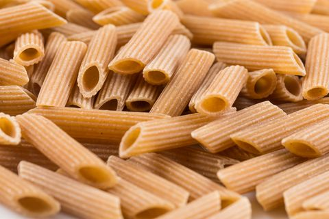 Wholemeal Pasta Penne as close-up shot for background