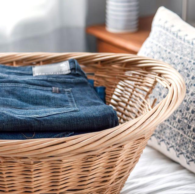 jeans in wicker laundry basket