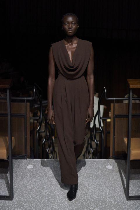 Fashion, Fashion model, Fashion design, Brown, Runway, Dress, Fashion show, Shoe, Haute couture, Style,