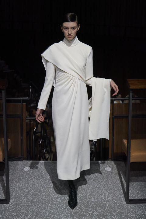 White, Clothing, Fashion, Fashion model, Fashion design, Outerwear, Dress, Haute couture, Coat, Runway,