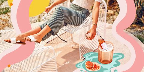 woman in summer clothes outside drinking winc summer water societe rose