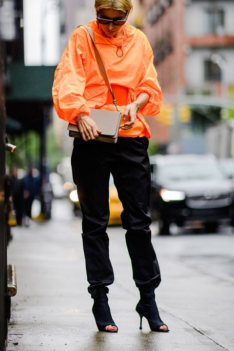 Street fashion, Orange, Yellow, Fashion, Snapshot, Human, Workwear, High-visibility clothing, Jeans, Outerwear,