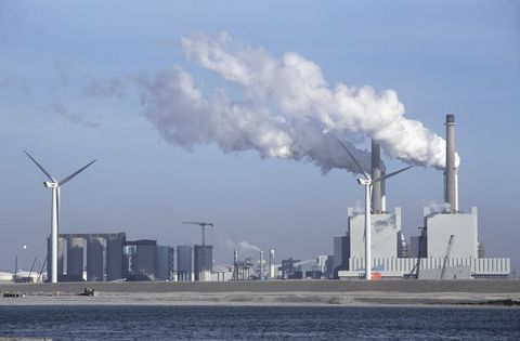 Windmill alongside coal fired power station in the Maasvlakte outer Rotterdam docks, Netherlands