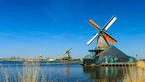 windmills on the riverbank, zaans schans, north of amsterdam, holland