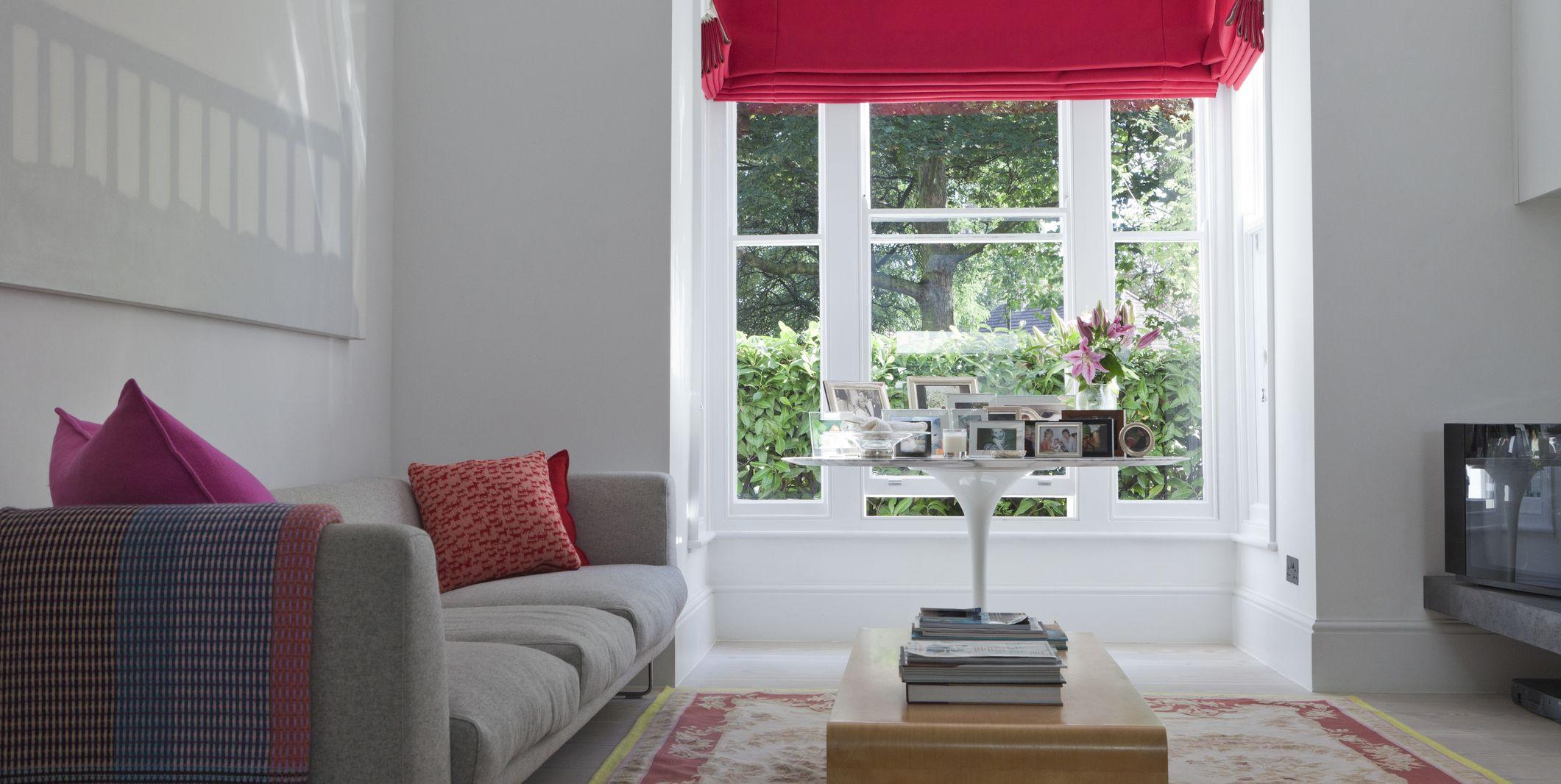 Window detail in living room of modern London family home, UK.