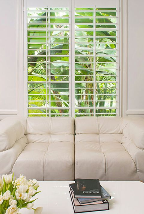 white sofa by window