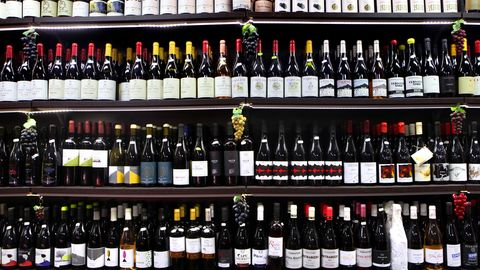 randazzo, sicily, italy   september 21 the shelves are filled with etna doc and other sicilian wines at the il buongustaio dell'etna wine bar on september 21, 2017 in the village of randazzo on the northern slope of mt etna in sicily, italy wine has been made in sicily for thousands of years and the island had a reputation for its bulk production and cheap wines but in the late 1980's a small group of local winemakers launched a revolution to make quality wines from indigenous grapes on the volcano's eastern slopes, amidst recent and ancient lava flows, lies the etna doc denominazione di origine controllata where three decades later some 300 wineries produce close to 1 million bottles of highly regarded and tightly regulated wine from 1620 acres of volcanic and mineral rich soil, mainly from the nerello mascalese and nerello cappuccio red grapes and carricante and catarratto white varietals photo by david silvermangetty images