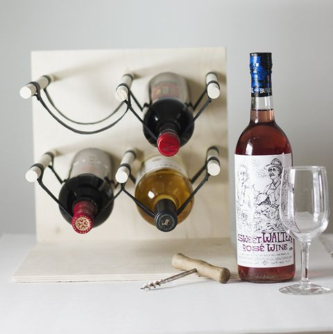 wine rack made of wood and rope