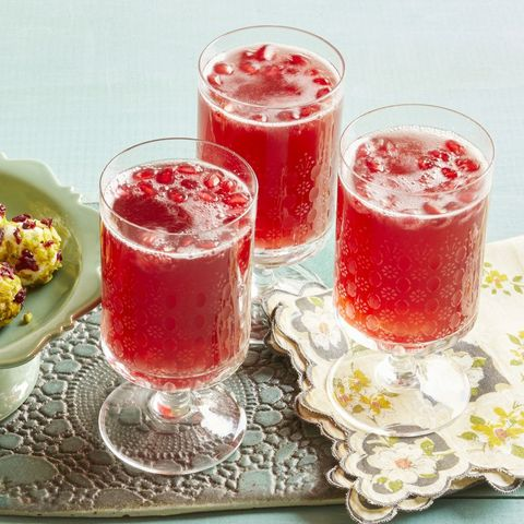 pomegranate sparklers with goat cheese balls on the side