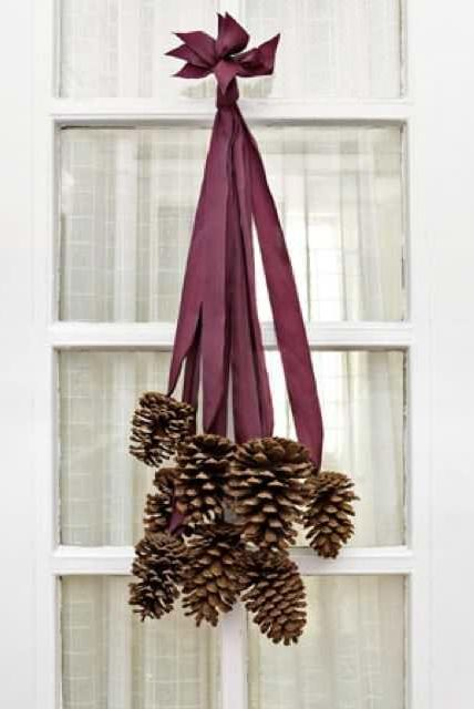 winter crafts pinecone door hanger