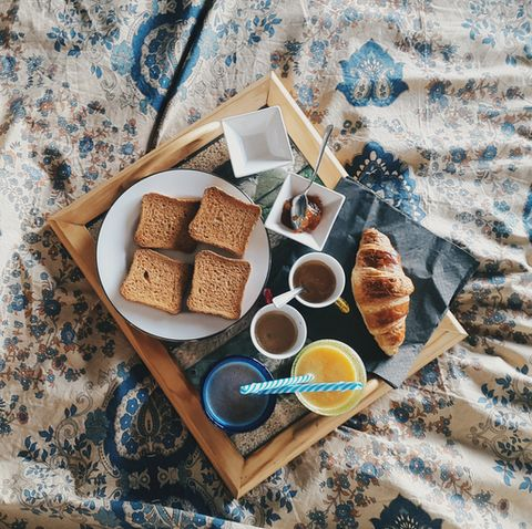 directly above view of fresh breakfast in tray on bed at home