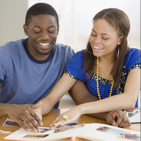 african couple making photo album