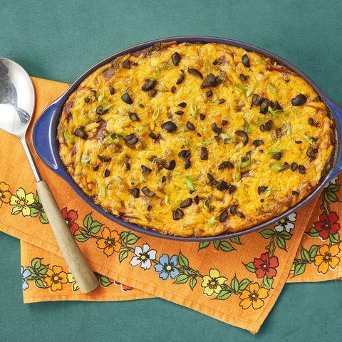 beef enchilada casserole on orange floral linen