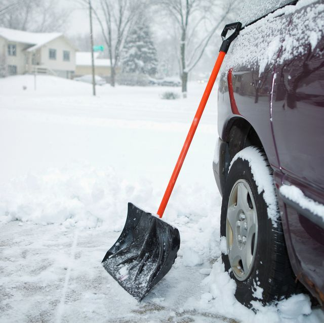 winter storm and snow shovel on driveway