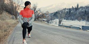 Winter Runner Stretching on Road