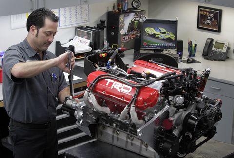 With an image of Nascar racer Matt Kenseth on his computer screen, Technician J.J. Ercse, (CQ) tigh