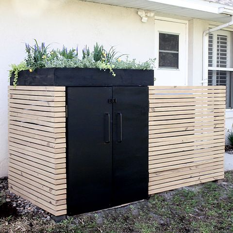 trash can and air conditioner screen
