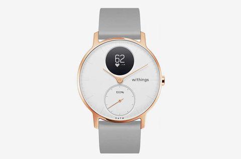 Product, Orange, Circle, Beige, Metal, Material property, Peach, Watch, Steel, Brand,