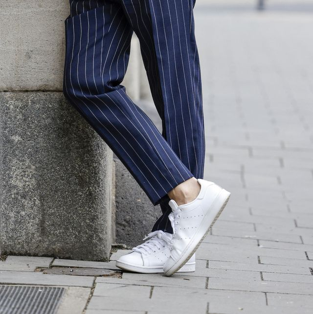 dusseldorf, germany   march 19 stylist bert sterck wearing a dark blue blazer by iris von arnim, a white button down shirt by dolce  gabbana, a white shirt by la perla, dark blue pants with white pinstripes by tagliatore, white sneaker by adidas   stan smith, a watch by cartier pasha and sunglasses by paris miki during a street style shooting on march 19, 2021 in dusseldorf, germany photo by streetstyleshootersgetty images