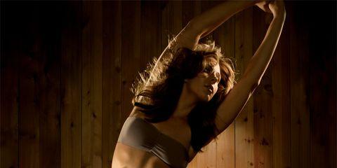 Tough Workout: Woman Stretching