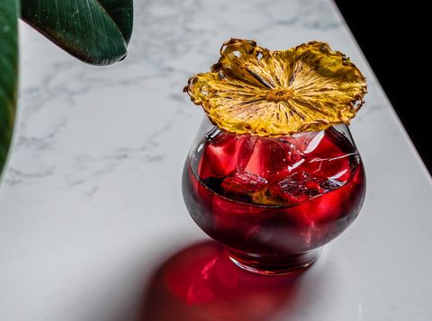 Red, Christmas ornament, Ornament, Glass, Plant, Drink, Fashion accessory, Flower, Holiday ornament, Christmas decoration,