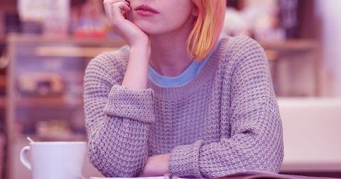 Woman alone in coffee shop