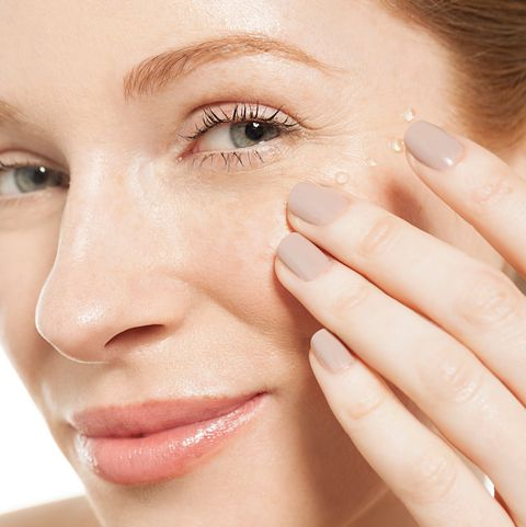 Woman applying eye gel