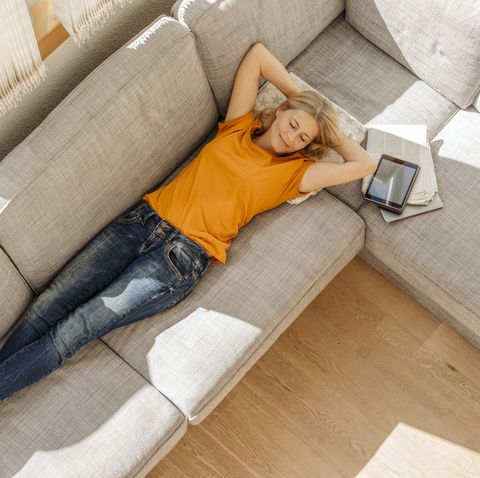 woman at home lying on couch