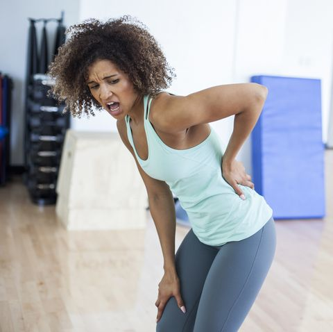 Woman at the Gym Experiencing Pain