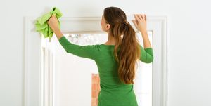 Woman dusting - cleaning tips