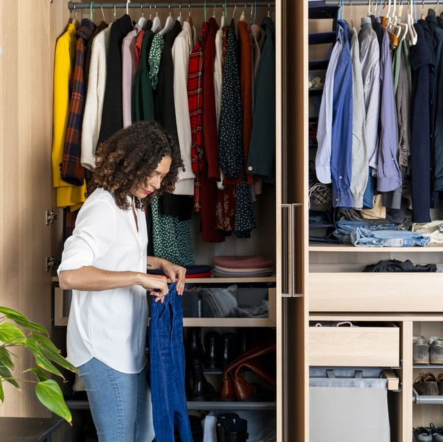 woman clearing out her wardrobe royalty free image