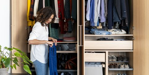 woman cleaning organized closet