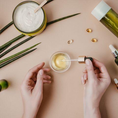 woman cosmetologist cosmetics testing