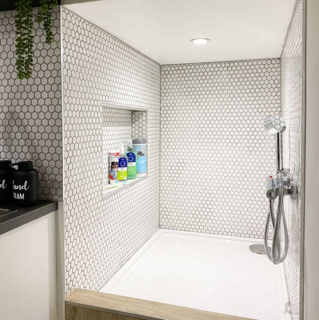 woman transforms garage into mini dog shower